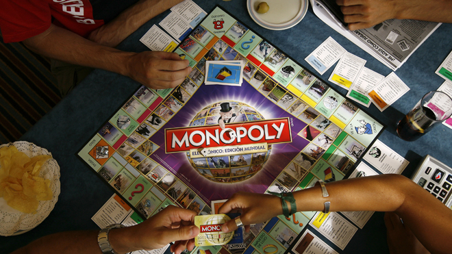 Players participate in a Guinness world record attempt taking place across the world for the largest simultaneous game of Monopoly, at a hotel in Madrid